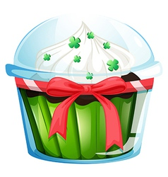 A cupcake container with a green cupcake and a vector
