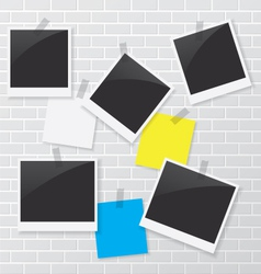 Photo frame and blank paper on brick wall vector