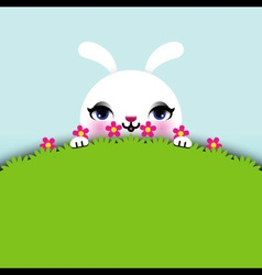 Easter bunny sitting in grass vector
