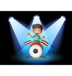 A young drummer in the middle of the stage vector