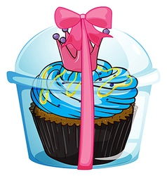A cupcake container with a pink ribbon vector