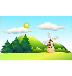 A windmill in the field vector