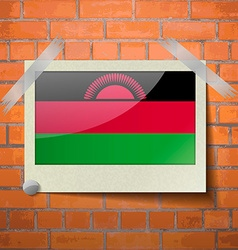 Flags malawi scotch taped to a red brick wall vector