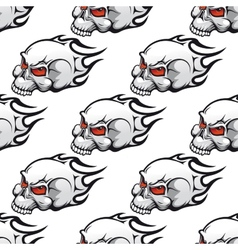 Cartoon skulls with tribal flames seamless pattern vector