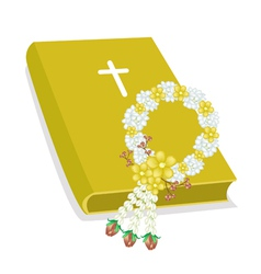 Holy bible with wooden cross and flower garland vector