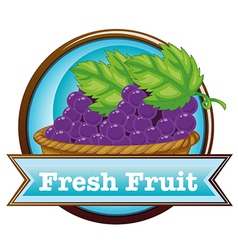 A fresh fruit label with a basket of grapes vector