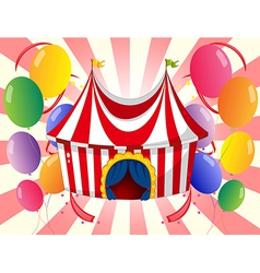 A red circus tent with colorful balloons vector