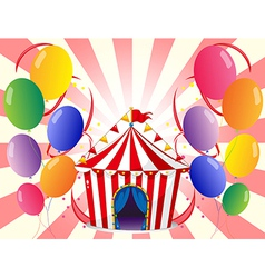 A red circus tent with balloons vector