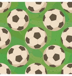 Soccer balls on grass seamless vector