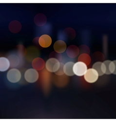 Blurred city at night background vector