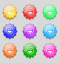 Funny face icon sign symbol on nine wavy colourful vector