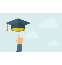 Hand pointing to graduation cap vector