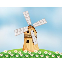 A barn with a windmill vector