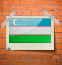 Flags uzbekistan scotch taped to a red brick wall vector