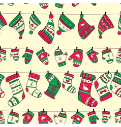 Winter seamless pattern with red green socks vector