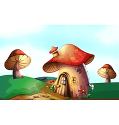 A mushroom house at the top of the hill vector
