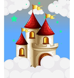 A castle in the sky with yellow banners vector