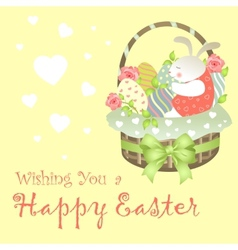 Easter bunny sitting in an basket vector