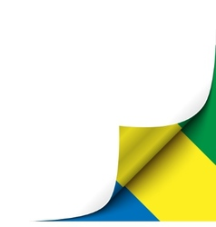 Curled up paper corner on gabonese flag background vector