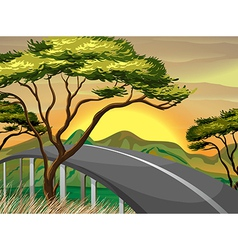 A narrow road near the mountains vector