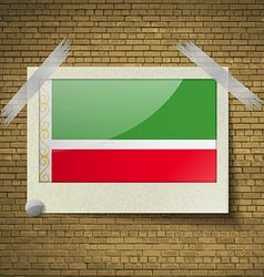 Flags chechen republic at frame on a brick vector