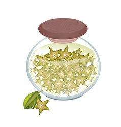 A jar of delicious pickled or preserved starfruits vector
