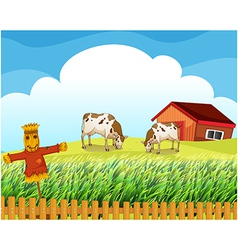 A scarecrow with two cows inside the fence vector