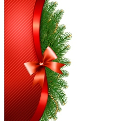 Christmas tree branches with a red ribbon and a vector