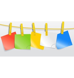 Blank color paper sheets on rope vector