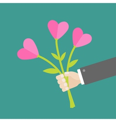 Businessman hand holding bouquet of heart flowers vector