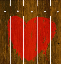 Painted red heart over wooden fence vector