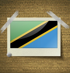 Flags tanzaniaat frame on a brick background vector