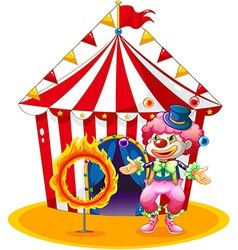 A female clown juggling in front of the tent vector