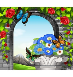 A stonewall with flowering plants and butterflies vector