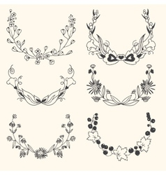 Set of floral hand drawn wreaths vector