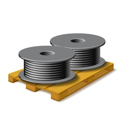 Coils with a black cord are on a wooden pallet vector