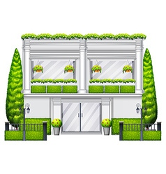 A commercial building with plants vector