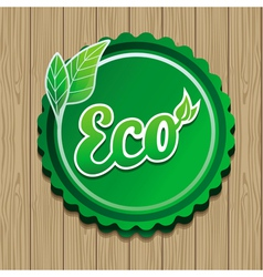 Eco label - green sticker on wooden backgro vector