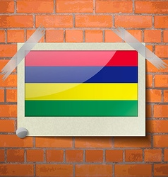 Flags mauritius scotch taped to a red brick wall vector