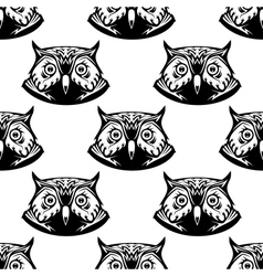 Seamless pattern of wise owl heads vector