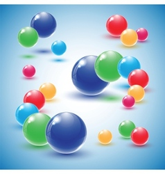 Different colour glass balls on blue background vector