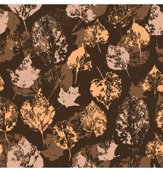 Seamless texture with stamped autumn leaves vector