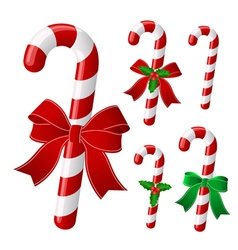 Candy cane collection with ribbon and holly vector