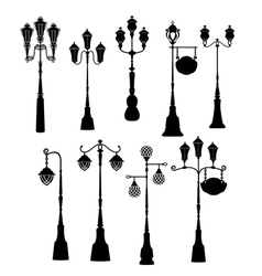 Set of retro street lanterns silhouettes vector