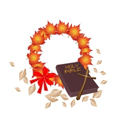 Holy bible with christmas wreath of orange maple vector