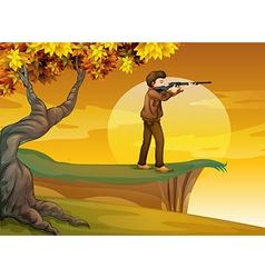 A boy holding a gun near the tree vector