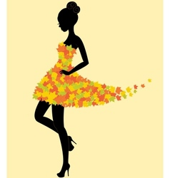 Dancer girl in dress of autumn leaves vector