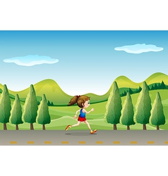 A girl jogging at the street with trees vector