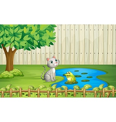 A cat and a frog inside the fence vector
