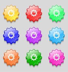 Sun icon sign symbol on nine wavy colourful vector